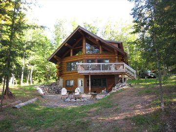 Solar Powered Authentic Log Cabin on Quiet Lake with 120 Acres Private Forest