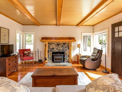 Photo for A pair of peaceful cottages w/ forest views, outdoor firepit, & great location!