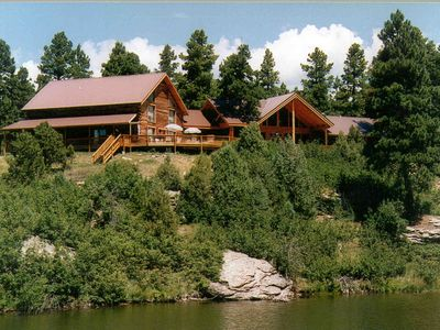 Photo for Lost Canyon Lake Lodge is a magnificent 2-story log house nestled in the pines.