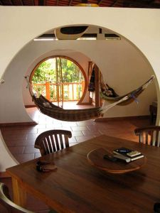 Pic inside the house. kitchen table/ hammocks/ round hallway/ glass round doors.