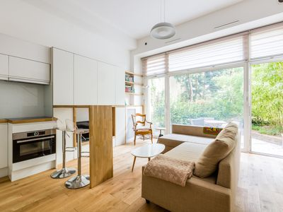 Photo for Contemporary 1BR mezzanine with garden minutes from Notre-Dame, by Veeve