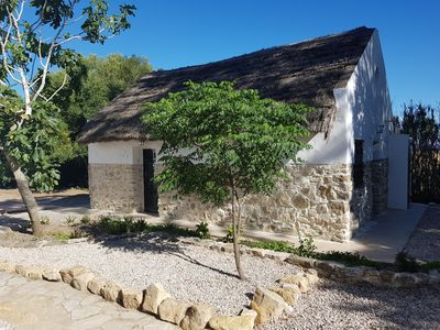Photo for Gorgeous tranquil thatched cottage in the  Andalusian countryside with pool.