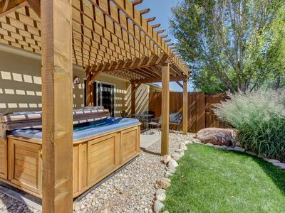 Photo for A private hot tub & shared pool await from this centrally located home!