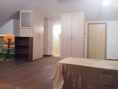 Photo for Near airport Attic with a double bed and two single beds in residence