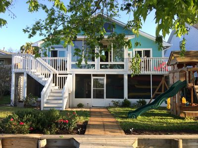 Photo for Paddler's Cove creek-front apartment, close to beach and downtown