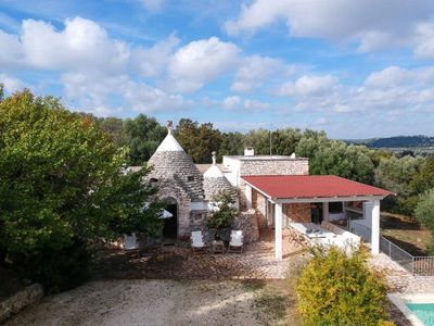 Photo for Enchanting trulli immersed in the greenery of Valle d'Itria, near Ceglie Messapica