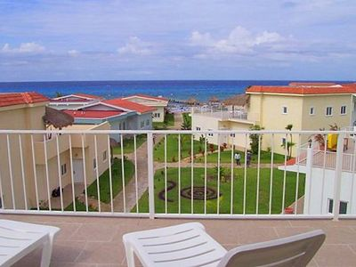 Photo for 3 BR Townhouse at Costa del Sol.  Beachfront Pool, Fast Internet, Near Reefs