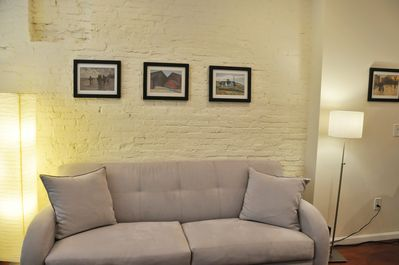 EXPOSED 9 FT HIGH BRICK WALL WITH QUEEN SOFA BED