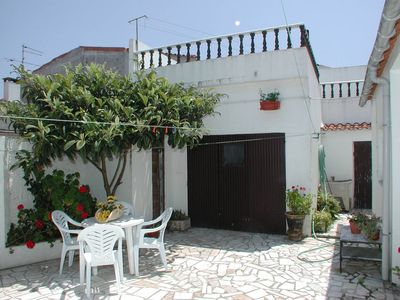 Photo for Typical Portuguese house near the sea with yard and sun terrace