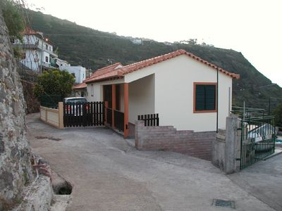 Photo for Traditional Madeira cottage, sea and mountain views over pool
