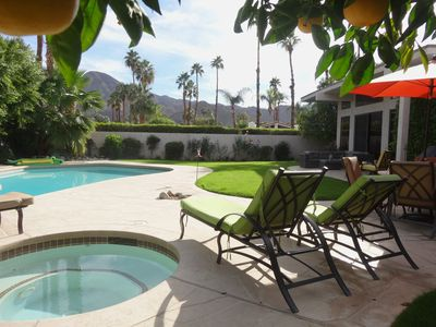 Spacious backyard, large pool, hot tub, luxurious chaise lounges, table/4 chairs