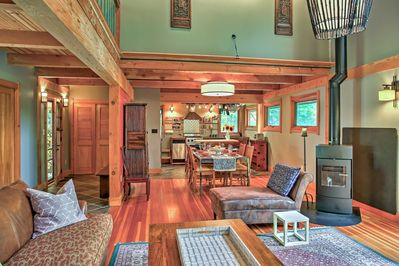 The space offers natural light, leather furnishings and a wood-burning stove.