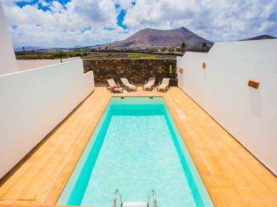 Photo for Private heated pool inviting to relax and have fun