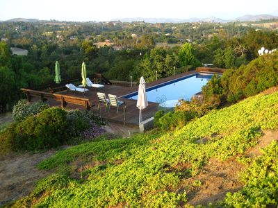 Backyard pool, redwood deck, chaise lounges, dining table, & spectacular views.