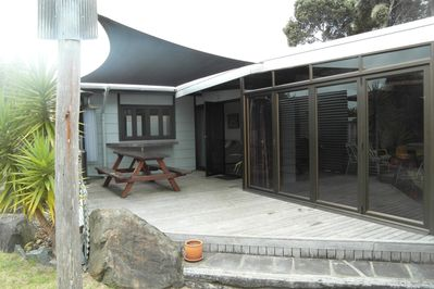 One of two outdoor decks with shade cloth