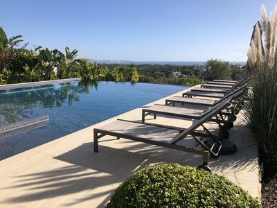 Photo for 4 Ensuite rooms, Fibre wifi & heated infinity pool-views of the valley & ocean.