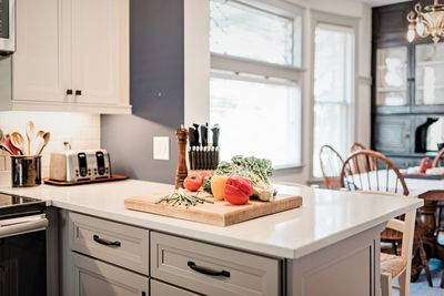 Kitchen peninsula with cutting board