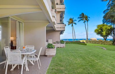 Photo for Maui Resort Rentals: The Whaler 124 - Luxurious Ground Floor Corner 1BR/2BA w/ Wrap-Around Balcony, Partial Ocean and West Maui Mountain Views, Large Adjacent Lawn Area