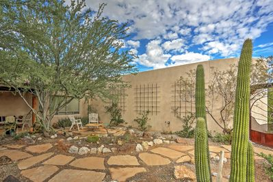 Admire the landscaping when you arrive at this Tucson vacation rental home!