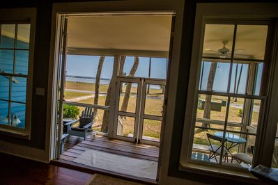 Great screened-in porch with ocean and beach just beyond...