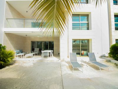 Photo for Stunning garden-unit right by the water, with great marina view!