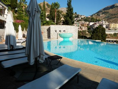 Photo for Wonderful apartment in Taormina with swimming pool, 5 minutes from greek theater