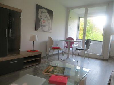 Photo for Modern, bright apartment with loggia and green views in the city center