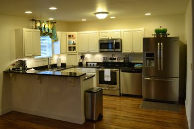Kitchen is fully equipped with new stainless steel appliance and well stocked.