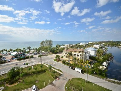 Photo for Spectacular 9th Floor Views and Sunsets! Steps to the beach. Free in suite WiFi.