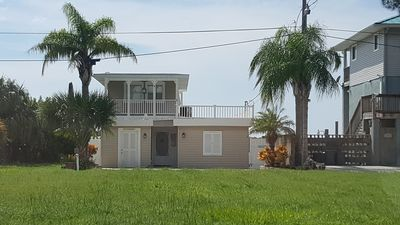 Photo for Paradise in Hudson, stunning Gulf views, with 1st class fishing and boating.