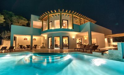 Photo for Breathtaking sunset villa by Ibiza's most beautiful beach. Staffed
