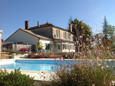 Photo for Stunning Maison de Maitre, large garden, private heated pool, sleeps 12+2