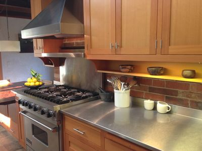Chef's kitchen outfitted with a 6 burner Viking stove and All-Clad cookware.