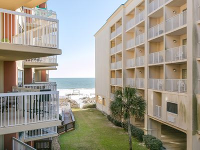 Photo for Beachfront condo w/ indoor & outdoor pools - near dining & shopping!