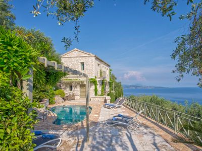 Photo for House with pool and stunning sea views, located on a hill of olive trees.