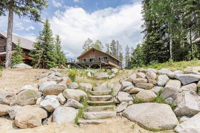 Stone staircase leading up to back exterior of cabin