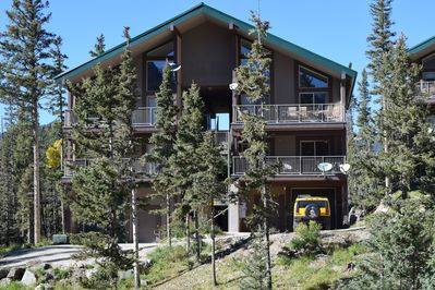 Condo is surrounded by mountain pines.  Has a garage for your auto and gear.