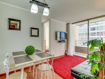 Photo for Lovely apartment w/ shared pool, fitness center, & a convenient central location
