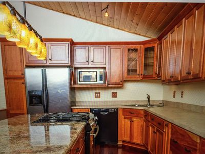 Fully furnished kitchen with spices, instant pot, coffee maker, dishes for 18