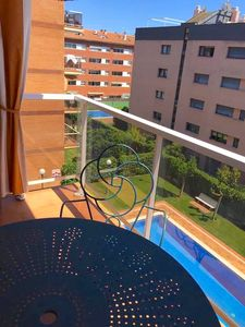 Photo for NICE APARTMENT NEAR THE BEACH WITH AIRCON, SWIMMING POOL, WIFI AND PARKING