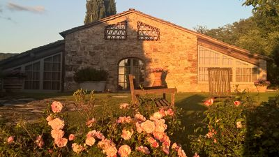 Photo for Exceptionally pretty cottage with pool, views, in walking distance from Panzano