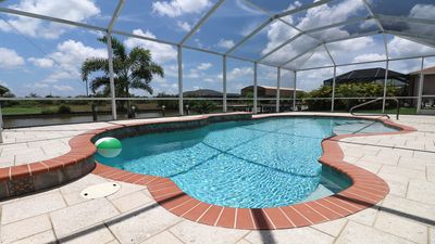Photo for Florida Getaway!  3 bedroom Waterfront Heated Pool Home - Beach, Golf, Relax!