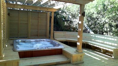 Six person hot tub and new first level entertainment deck.