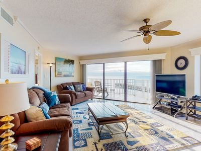 Photo for Sunny, beachfront condo w/shared pool, access to beach/attractions