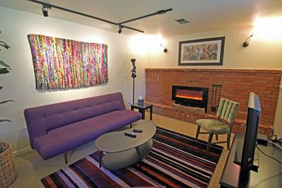 Colorful, warm, fireplace, satellite TV -- what's not to like?