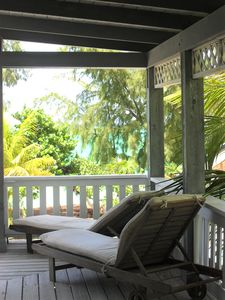 Balcony overlooking lush tropical vegetation and beach