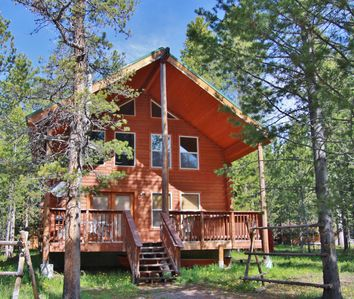 Front of cabin on a warm sunny summer day.  Paradise found.