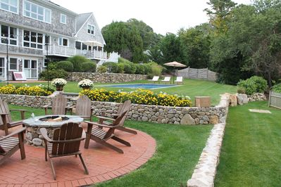 Fire pit, horseshoes pit and custom crafted rock walls with abundant landscapin