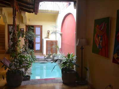 Pool area,looking to downstairs BD. Bright/colorful really,but site dulls photo
