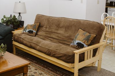 Full size futon in living room can sleep 2 guests
